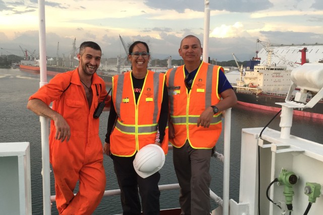 Sgt. 1st Class Humberto Castellanos (right) with a co-worker (center) and first mate of a vessel.
