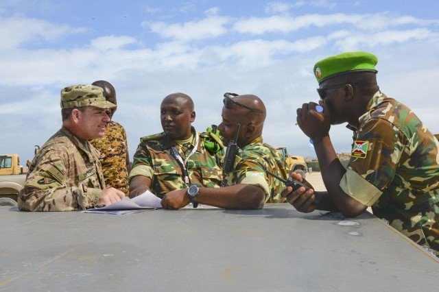 U.S. Army Capt. Mike Smith, left, Combined Joint Task Force - Horn of Africa Military Coordination Cell logistics representative, reviews an item list with Capt. Ndikumana, center right, Burundi National Defense Force African Union Mission in Somalia Burundi contingent team leader, in Mogadishu, Somalia, Sept. 12, 2016. Burundi forces received more than 10 power generators, tires and spare parts for Mine Resistant Ambush Protected vehicles to remedy the wear and tear on vehicle parts caused by rough and uneven terrain. The MRAP vehicles are vital to keeping AMISOM forces safe from roadside bombs planted by al-Shabaab throughout Somalia. (U.S. Air Force photo by Staff Sgt. Benjamin Raughton)