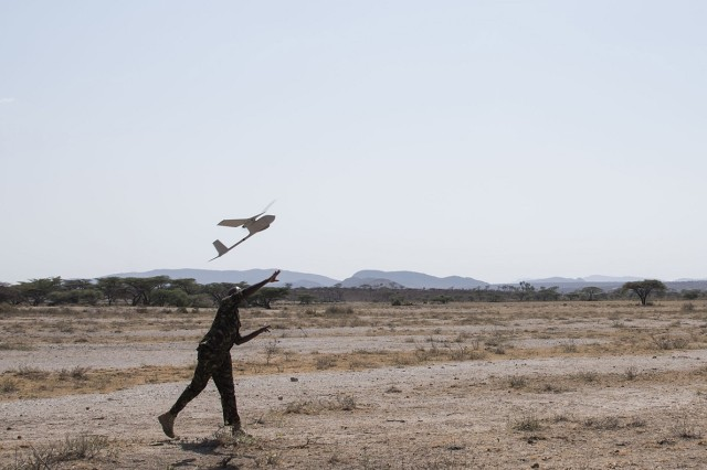Kenya Defense Force Cpl Ezekiel, assigned to the KDF Military Intelligence Battalion, launches an AeroVironment RQ-11 Raven, an unmanned aerial vehicle, during training with U.S. Army Soldiers of the 1st Battalion, 124th Infantry Regiment, Sept. 13, 2016, at a Kenyan training facility. Assigned to Combined Joint Task Force-Horn of Africa, the 1/124th Inf. Rgt., provided basic training on assembly, disassembly, repair, and preventative maintenance in regard to basic mission planning and advanced flight plans for the Raven. (U.S. Air Force photo by Staff Sgt. Tiffany DeNault)
