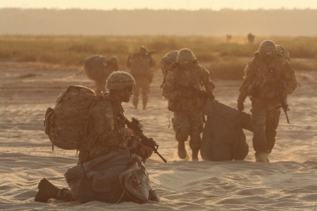Paratroopers assigned to Company D, 2nd Battalion, 503rd Infantry Regiment, 173rd Airborne Brigade, prepare for movement from the drop zone following airborne insertion exercise Bayonet Strike at D�brówka lookout in Chech�o, Poland, Sept. 12, 2016. The 173rd Airborne Brigade, based in Vicenza, Italy, is the Army Contingency Response Force in Europe, and is capable of projecting forces to conduct a full range of military operations across the United States European, Central and Africa Command areas of responsibility within 18 hours. Operation Atlantic Resolve is a U.S. led effort in Eastern Europe that demonstrates U.S. commitment to the collective security of NATO and dedication to enduring peace and stability in the region.
