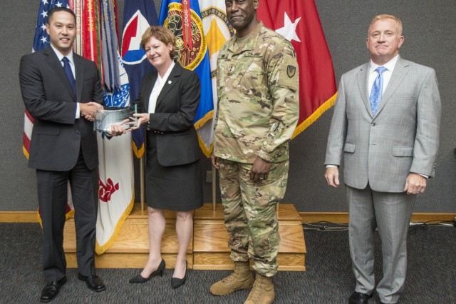 "Robert DiLalla -- an engineer and team leader at the Natick Soldier Research, Development and Engineering Center -- was presented the FY2015 Maj. Gen. Harold ""Harry"" J. Greene Award for Innovation in the Individual -- Civilian Award Category during a ceremony at NSRDEC on Sept. 19. During the ceremony DiLalla (far left) was commended by Lisha H. Adams (second from left), executive deputy to the commanding general at the U.S. Army Material Command, Maj. General Cedric T. Wins (second from right), commanding general of the U.S. Army Research, Development and Engineering Command, and NSRDEC Director Douglas A. Tamilio (far right)."