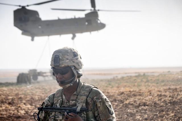 Task Force Strike Artillerymen, aviators conduct sling load training