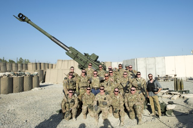U.S. Army artillerymen assigned to 3rd Cavalry Regiment pose for a photo with Secretary of the Army Eric Fanning in front of their M777 towed 155mm howitzer after conducting their fire mission at Tactical Base Gamberi, Afghanistan Sept. 16, 2016.