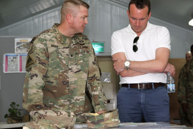 Col. Robert E. Lee Magee, commander of the 3rd Armored Brigade Combat Team, 1st Infantry Division, left, discusses his operations with Secretary of the Army Eric Fanning during a tour Sept. 19 at Camp Buehring, Kuwait. Fanning met with U.S. Army Central Soldiers throughout Kuwait who support missions in 20 countries in the Middle East and Southwest Asia. (U.S. Army photo by Sgt. Brandon Hubbard)