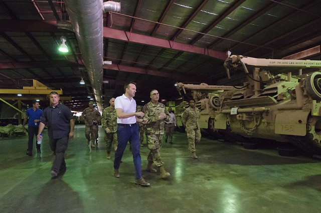 U.S. Army Secretary Eric Fanning speaks with Soldiers during a warehouse tour September 19, part of the rolling stock of the 401st Army Field Support Brigade, at Camp Arifjan, Kuwait. The brigade maintains millions of dollars in equipment in Army warehouses in Kuwait as part of U.S. Army Central's support network for the 20-nation Central Command area of operations. (U.S. Army photo by Justin Graff, 401st AFSB Public Affairs)