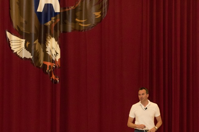U.S. Army Secretary Eric Fanning takes to stage during a town hall meeting September 19 with Soldiers at Camp Arifjan, Kuwait. The top Army civilian spoke to a filled auditorium of more than 200 Soldiers from primarily U.S. Army Central about the current state of the Army in its unique time of shrinking budgets and multiple missions throughout the Middle East. (U.S. Army photo by Sgt. Brandon Hubbard)