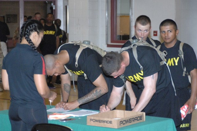 Fort Leonard Wood Soldiers sign up to take part in timed trials on the Alpha Warrior Battle Rig Sept. 13 at Davidson Fitness Center.