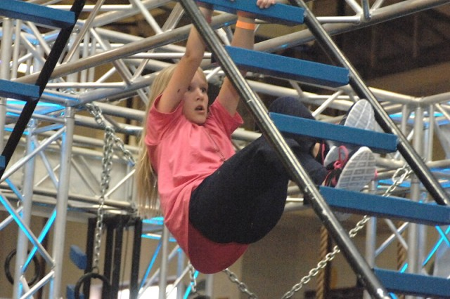 Mary Carlson, 12, climbs along the ladder obstacle during the Alpha Warrior Battle Rig Demo held Sept. 13 at Davidson Fitness Center on Fort Leonard Wood.