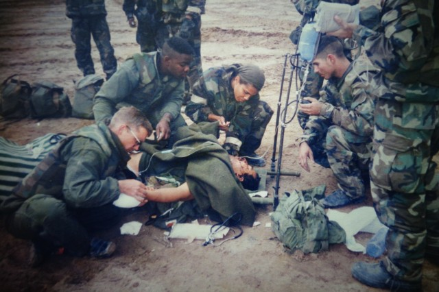 Center, now Lt. Gen. Nadja West, Army Surgeon General and Commanding General, U.S. Army Medical Command, is shown during Operation Desert Storm treating a wounded Iraqi soldier.