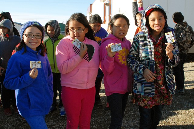 Fourth-graders from Nome Elementary School in Nome, Alaska, show their Every Kid in a Park passes they received from Jo-Ellen Darcy, assistant secretary of the Army for civil works, Sept. 14 on the school's playground. In its second year, Every Kid in a Park is a presidential initiative that provides free passes to fourth-graders and their families to all national parks in the U.S. The purpose of the program is to bridge the growing disconnect between the next generation and the great outdoors, and to inspire children to become future stewards of the nation's natural and historic treasures. The U.S. Army Corps of Engineers is one of several participating agencies in the program. Pictured, from left to right, are Nome Elementary School fourth-graders Sienna Pederson, Julia Sinnok, Hanalori Callahan and Aries Pilcher-Fanroy.