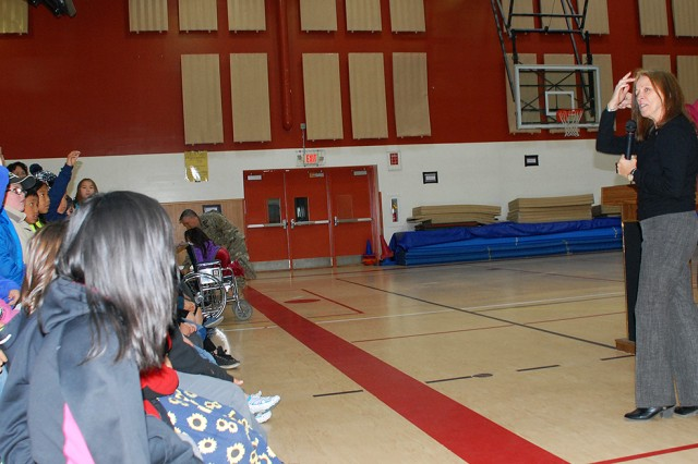 Jo-Ellen Darcy, assistant secretary of the Army for civil works, answers questions from fourth-grade students during an Every Kid in a Park outreach event Sept. 14 in the Nome Elementary School gym in Nome, Alaska, as Kevin Theonnes, Nome Elementary School principal, looks on. In its second year, Every Kid in a Park is a presidential initiative that provides free passes to fourth-graders and their families to all national parks in the U.S. The purpose of the program is to bridge the growing disconnect between the next generation and the great outdoors, and to inspire children to become future stewards of the nation's natural and historic treasures. The U.S. Army Corps of Engineers is one of several participating agencies in the program.