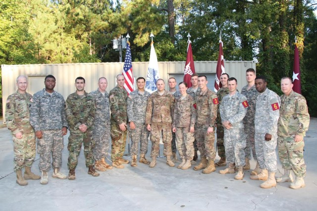 The leadership team from Regional Health Command-Atlantic, Brig. Gen. Ronald Place, commanding general, and Command Sgt. Maj. Matthew Brady, RHC-A's command sergeant major, stand with the RHC-A Best Medic Competition competitors.