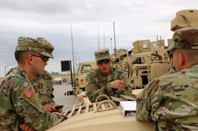 Soldiers discuss their plan of action during the Validation Exercise in preparation for Army Warfighting Assessment 17.1 at the Integration Motor Pool at Fort Bliss, Texas.