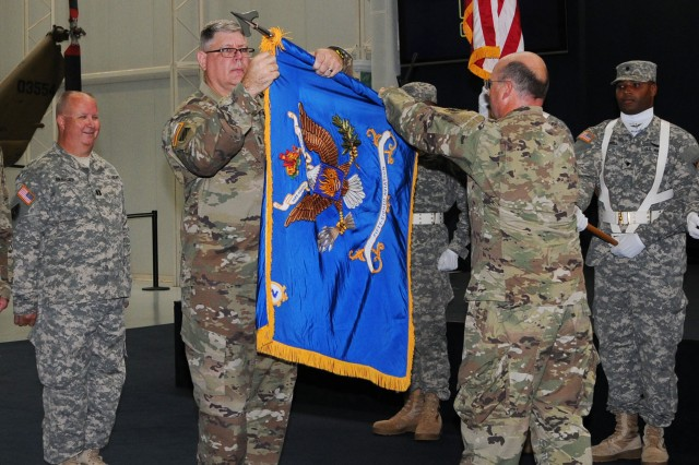Lt. Col. Daniel McClintock (right), outgoing 2-58th Avn. Regt. commander, cases the unit colors during an inactivation ceremony at the U.S. Army Aviation Museum Sept. 17.