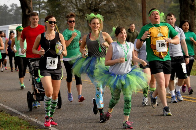 Runners dress in their St. Patrick's Day best as they participate in the Shamrock Shuffle 5K/10K race last year.