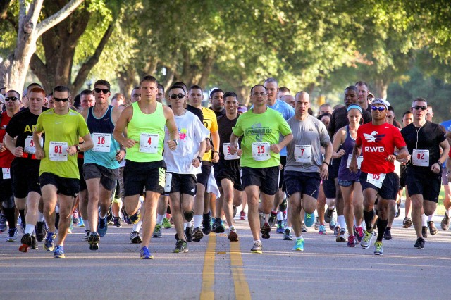 Runners take their opening strides during the inaugural Hispanic Heritage Half Marathon last year. This year's race begins at 7 a.m. Sept. 24.