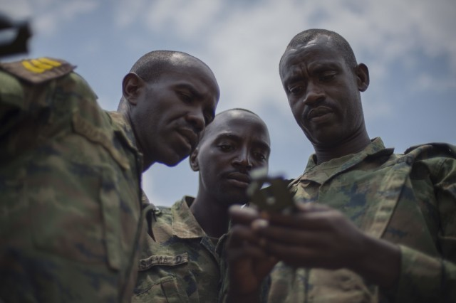 Rwanda Defense Force noncommissioned officers use a compass to gather direction and heading during a land navigation portion of their NCO leadership training Sept. 8, 2016, at the Rwanda Military Academy, Rwanda. Members of 1st Battalion, 124th Infantry regiment, who are deployed from the Army National Guard to Combined Joint Task Force - Horn of Africa, observed the NCO course to provide advice and critiques to improve the class. (U.S. Air Force photo by Staff Sgt. Eric Summers Jr.)
