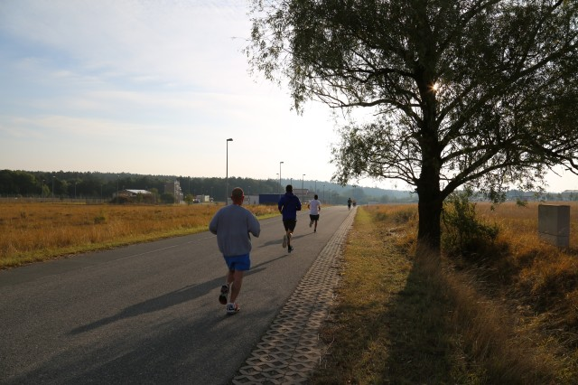 ANSBACH, Germany (Sept. 23, 2016) -- Community members run through Urlas Community. As part of September as Suicide Prevention Awareness Month, U.S. Army Garrison Ansbach's Army Substance Abuse Program hosted a three-kilometer run / walk at Urlas Community here Wednesday. (U.S. Army photo by Bryan Gatchell, USAG Ansbach Public Affairs)