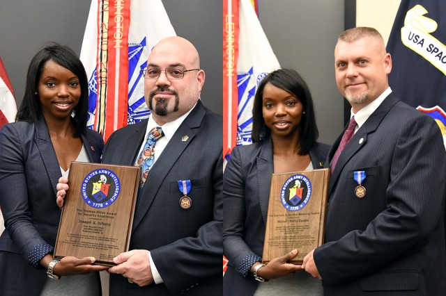 Joy Assent, Security Division chief, Department of the Army, Office of the Chief of Staff for Intelligence (G-2), presents the U.S. Army Space and Missile Defense Command/Army Forces Strategic Command's Joseph S. DiNoto (left) and Michal D. Gussie (Right) with the Army's top two security awards during a ceremony at the USASMDC/ARSTRAT headquarters Sept. 23. DiNoto, SMDC chief security officer, received the Thomas Dillon Award for Security Excellence, and Gussie, SMDC deputy foreign disclosure officer, received the Kenneth C. Raymer Award for Excellence in Foreign Disclosure.