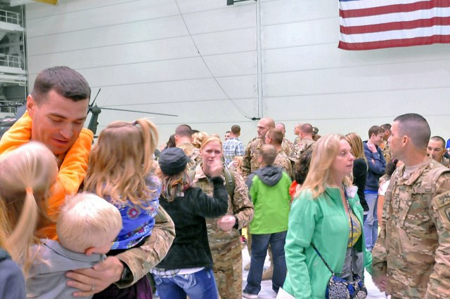 Soldiers assigned to 1st Battalion, 52nd Aviation Regiment are welcomed home at Fort Wainwright's Hangar 6 upon their return from a deployment to Afghanistan in support of Operation Enduring Freedom, Sept. 29, 2014. (U.S. Army photo by Capt. Matt Baldwin, USARAK Public Affairs North/Released)