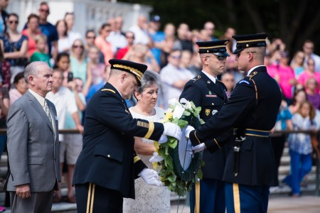 Chief of Staff of the Army Gen. Mark A. Milley, second from left, and Candy Martin, president of American Gold Star Mothers Inc., lay a wreath at the Tomb of the Unknown Soldier in Arlington National Cemetery, Sept. 25, 2016, in Arlington, Va. The wreath was laid in honor of the 80th Gold Star Mother's Day.
