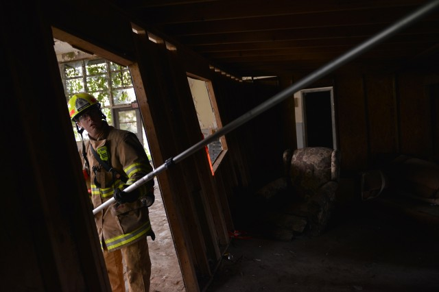 A Firefighter from Fairfax County Fire and Rescue checks the air quality in a structurally compromised building during urban search and rescue training at Lorton Youth Detention Center, Lorton, Virginia, Sept. 21, 2016. This training is a part of Capital Shield 2016.
