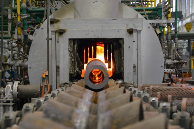 """A 155 mm artillery tube enters a heat treatment furnace at Watervliet Arsenal in New York as part of a process called """"austenitizing."""" Watervliet is one of 23 depots, arsenals and ammunition plants managed by AMC that make up the Army's Organic Industrial Base."""