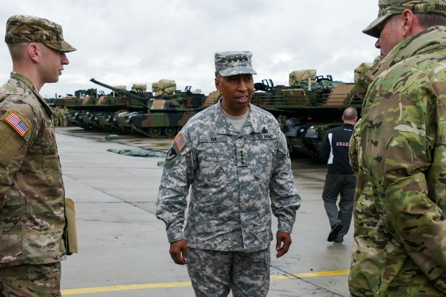 Gen. Dennis L. Via, commanding general of U.S. Army Materiel Command, talks with Soldiers from the 1st Brigade Combat Team, 3rd Infantry Division, during the unit's draw of equipment from the European Activity Set, a brigade-sized set of equipment maintained by the 405th Army Field Support Brigade for use by rotational forces, Sept. 17, 2015. Via visited sustainment and materiel sites throughout Europe to assess how AMC supports U.S. Army Europe.