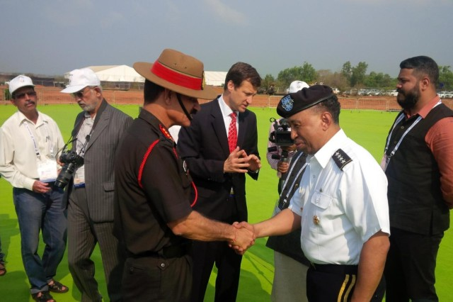 Army Materiel Command's Commander Gen. Dennis L. Via meets with Indian army chief of staff Gen. Dalbir Singh at the opening ceremony of India's Defexpo 2016.