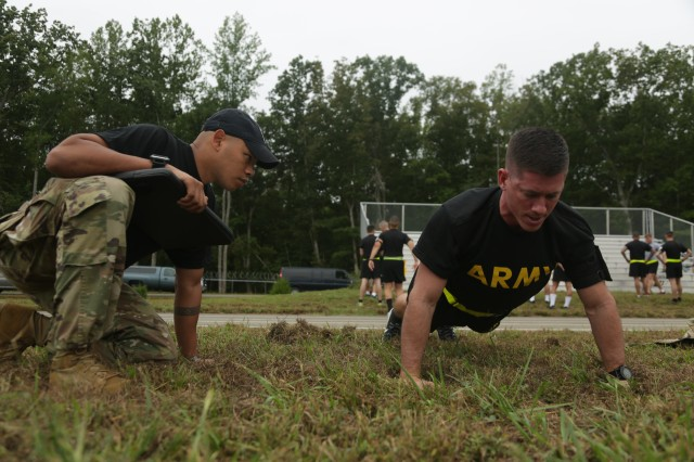 U.S. Army Spc. Joseph Broam, assigned to National Guard Bureau, performs push-ups during the Army Physical Fitness Test as part of the Best Warrior Competition at Fort A.P. Hill, Va., Sept. 26, 2016. The competition is a week long event that tests the skills, knowledge, and profession of 20 warriors representing 10 commands. (U.S. Army Photo by Spc. Ayla Seidel)
