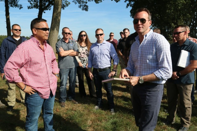 GRAFENWOEHR, Germany (September 26, 2016) -- The Secretary of the Army, the Honorable Eric Fanning (right) thanks Brig. Gen. Antonio Aguto (left) and the staff of the 7th Army Training Command on Drop Zone Tango in Holland, Sept. 21, 3016. The Secretary of the Army and his staff joined the 7ATC team on a Battle Staff Ride to the 72nd anniversary of Operation Market Garden.