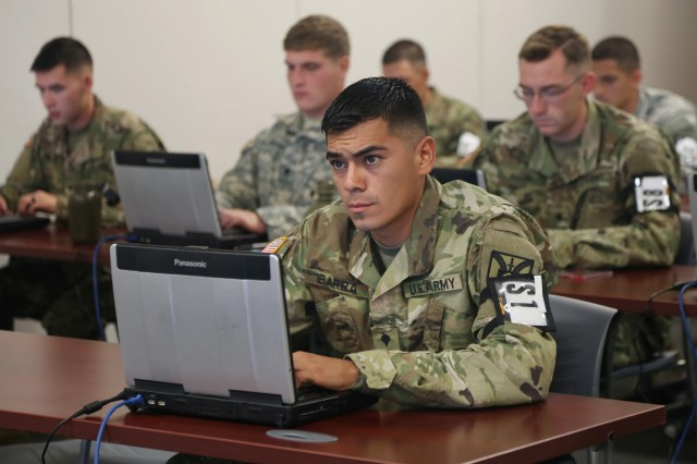 U.S. Army Spc. Alan Ibarra-Lepe, assigned to U.S. Army Forces Command, types a 400-word essay on improving Soldier readiness, during the U.S. Army 2016 Best Warrior Competition (AWC) at Fort A.P. Hill, Va., Sept. 26, 2016. The BWC is an annual weeklong event that will test 20 Soldiers from 10 major commands on their physical and mental capabilities. The top NCO and Soldier will be announced Oct. 3, in Washington DC.