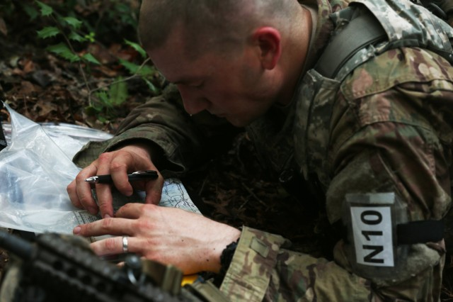 U.S. Army Staff Sgt. Andrew Crump, assigned to Army Cyber Command, plots points on a map during the land navigation portion of the U.S. Army 2016 Best Warrior Competition (BWC) at Fort A.P. Hill, Va., Sept. 27, 2016. The BWC is an annual weeklong event that will test 20 Soldiers from 10 major commands on their physical and mental capabilities. The top NCO and Soldier will be announced Oct. 3, in Washington DC.