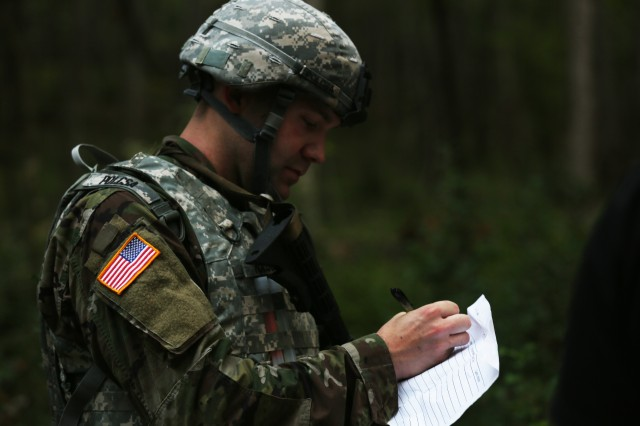 U.S. Army Staff Sgt. Joseph Polcsa, assigned to U.S. Army Pacific, plots points on a map during the land navigation portion of the U.S. Army 2016 Best Warrior Competition (BWC) at Fort A.P. Hill, Va., Sept. 27, 2016. The BWC is an annual weeklong event that will test 20 Soldiers from 10 major commands on their physical and mental capabilities. The top NCO and Soldier will be announced Oct. 3, in Washington DC.