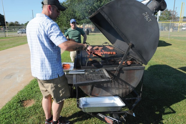 The 209th Military Police Detachment grilled burgers, hot dogs and sausages Sept. 23 to celebrate the MP Corps' 75th anniversary.