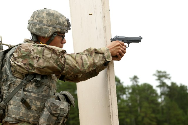 U.S. Army Spc. Alan Ibarra-Lepe, assigned to U.S. Army Forces Command, fires an M9 pistol during the U.S. Army 2016 Best Warrior Competition (BWC) at Fort A.P. Hill, Va., Sept. 28, 2016. The BWC is an annual weeklong event that will test 20 Soldiers from 10 major commands on their physical and mental capabilities. The top NCO and Soldier will be announced Oct. 3, in Washington DC.
