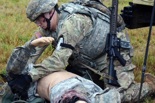 A Best Warrior competitor tends to a wounded Soldier Sept. 28, 2016 at Fort A.P. Hill, Virginia.