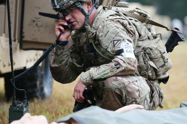 U.S. Army Staff Sgt. Ethan Rogers, assigned to U.S. Army Europe, demonstrates his marksmanship and tactical combat casualty care capabilities during a live-fire exercise on Day Three of the U.S. Army 2016 Best Warrior Competition (BWC), at Fort A.P. Hill, Va., Sept. 28, 2016. The BWC is an annual weeklong event that will test 20 Soldiers from the 10 major commands Army-wide, on their physical and mental capabilities. The top NCO and Soldier will be announced Oct. 3, in Washington DC.