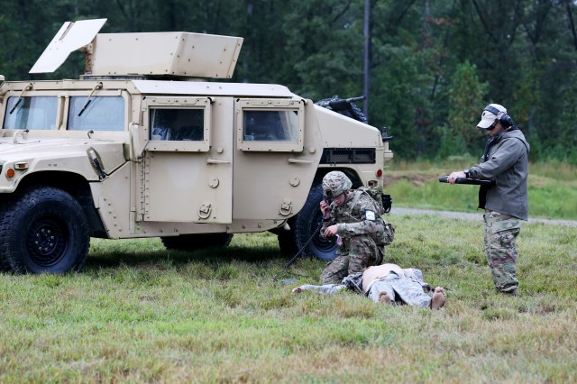 U.S. Army Spc. Daniel Guenther, assigned to U.S. Army Europe, demonstrates his marksmanship and tactical combat casualty care capabilities during a live-fire exercise on Day Three of the U.S. Army 2016 Best Warrior Competition (BWC) at Fort A.P. Hill, Va., Sept. 28, 2016. The BWC is an annual weeklong event that will test 20 Soldiers from the 10 major commands Army-wide, on their physical and mental capabilities. The top NCO and Soldier will be announced Oct. 3, in Washington DC.