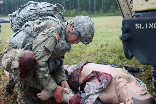 U.S. Army Staff Sgt. Alan Ibarra-Lepe, assigned to U.S. Army Forces Command, demonstrates his marksmanship and tactical combat casualty care capabilities during a live-fire exercise on Day Three of the U.S. Army 2016 Best Warrior Competition (BWC) at Fort A.P. Hill, Va., Sept. 28, 2016. The BWC is an annual weeklong event that will test 20 Soldiers from the 10 major commands Army-wide, on their physical and mental capabilities. The top NCO and Soldier will be announced Oct. 3, in Washington DC.