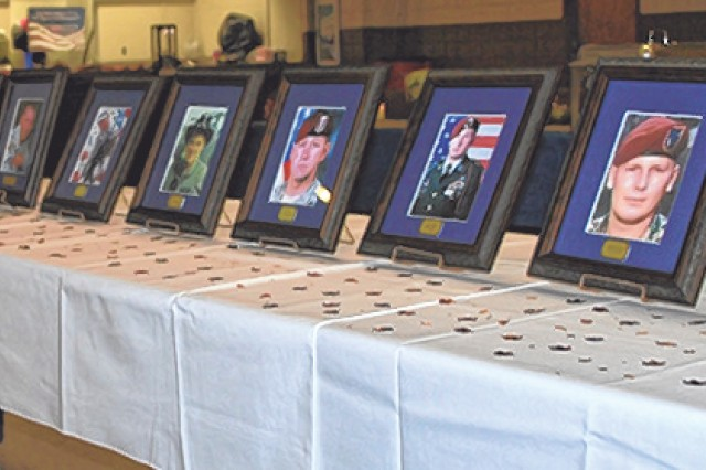 Photos of fallen service members honored at the Gold Star Mothers' and Families Remembrance Concert Sept. 18 at the USO. Courtesy photo