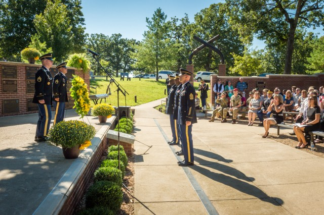 Brig. Gen. Kevin Vereen, chief, Military Police Regiment and MP School commandant, Regimental Command Sgt. Maj. Richard Woodring and Regimental Chief Warrant Officer Leroy Shamburger, salute a wreath laid in honor of the fallen MP Soldiers during the Memorial Tribute.