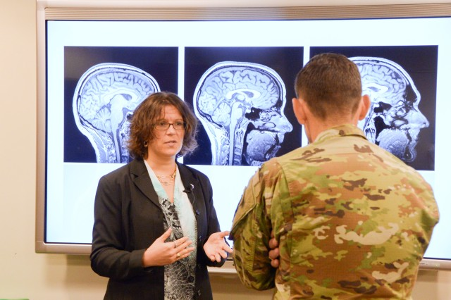 Army neuroscientist Dr. Jean Vettel (left) briefs Maj. Gen. Eric Wesley on her research of combining human skills with computer algorithms to optimize target identification and further machine learning.