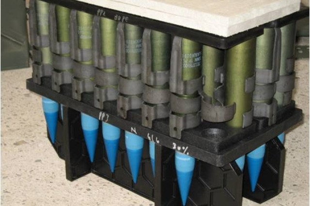 The improved, ridged-plastic dunnage was designed to improve support of the ammunition during drop and vibration scenarios.