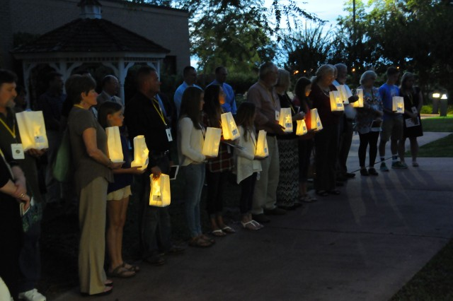 Gold Star family members line up as they light their luminaries in honor of their fallen Soldier during a Gold Star Mothers and Family Day at the main post chapel Sept. 25.