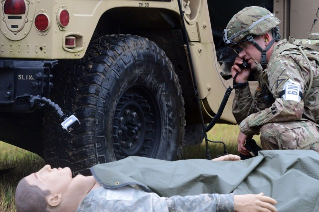 A Best Warrior competitor has to think fast as he's taking enemy fire and has a dying casualty to attend to at Sept. 28 at Fort A.P. Hill, Virginia.