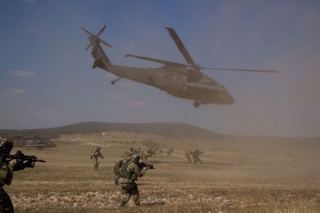 Army Special Forces and their NATO allied counterparts conduct an air assault on a small compound, Sept. 27, 2016, during Brave Warrior 2016/Black Swan at Bakony Combat Training Center, Hungary. The 3rd Battalion, 501st Aviation Regiment, 1st Armored Division, Combat Aviation Brigade, provided UH-60 Black Hawk support for the training mission. The exercise brings nations together to enhance interoperability and strengthen allied relationships.