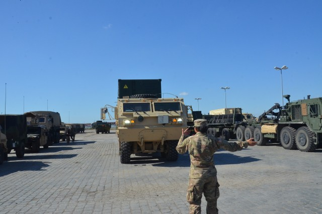 A 3ID Soldier ground guides a vehicle into the staging area at Coleman Work Site, Mannheim, Germany, Sept. 29.