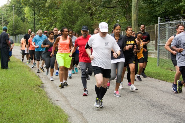 RICHMOND, Va. - Runners and walkers take off at the start line for the Suicide Prevention Awareness 5K Fun Run/Walk at the Defense Supply Center here, on Sep. 28, 2016. The 80th Training Command (TASS) held the event for all Department of Defense employees and their families. (Photo by Maj. Addie Randolph, 80th Training Command (TASS) Public Affairs)