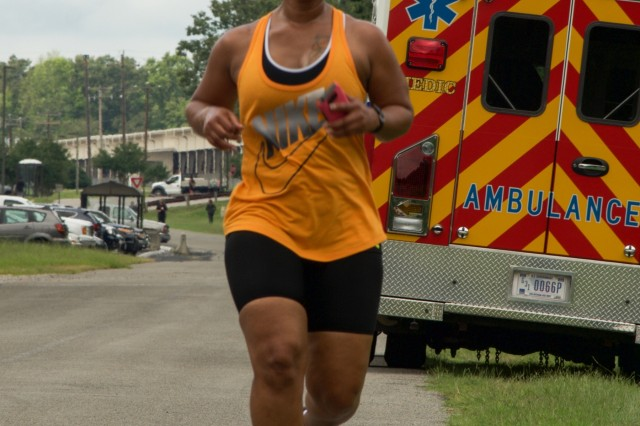 RICHMOND, Va. - Ms. Subretta Pompey, human resources specialist for the 80th Training Command (TASS), runs toward the finish line of the Suicide Prevention Awareness 5K Fun Run/Walk at the Defense Supply Center held here on Sep. 28, 2016. The 80th TC held the event for all Department of Defense employees and their families. (Photo by Maj. Addie Randolph, 80th Training Command (TASS) Public Affairs)